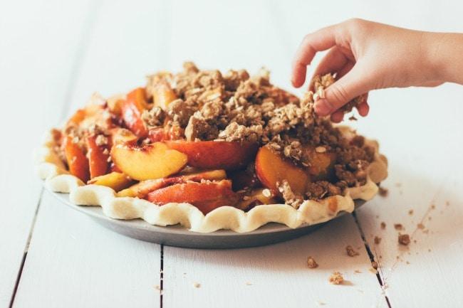 Placing Crumble Topping on Peach Pie | Sarah Kieffer | The Vanilla Bean Blog