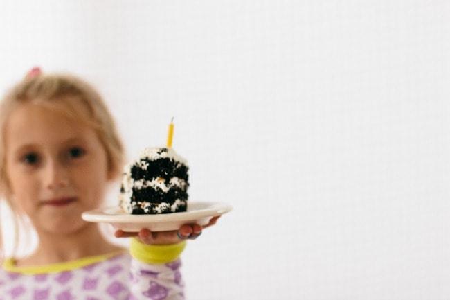 Girl Holding S'more Cake Slice | The Vanilla Bean Blog | Sarah Kieffer
