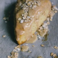 maple oatmeal scones on a piece of parchment paper