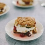 sour cherry shortcakes on white plates
