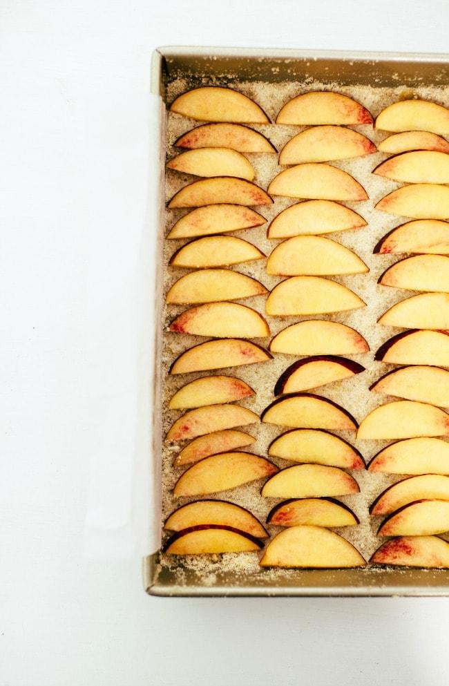 Peaches dusted in sugar on a baking pan | Sarah Kieffer | The Vanilla Bean Blog