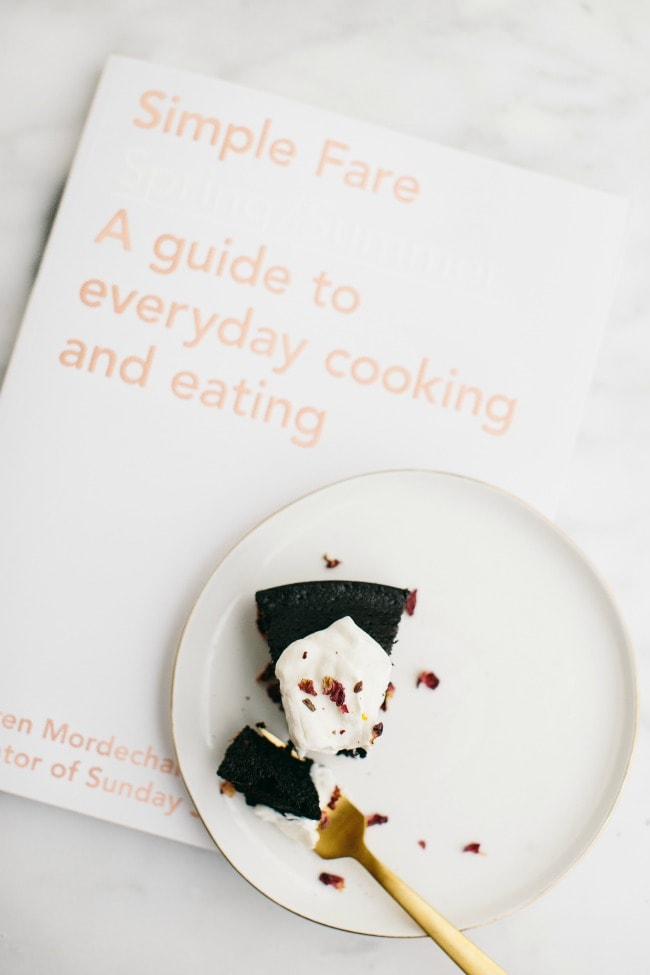 Simple Fare Cookbook with a slice of chocolate olive oil cake