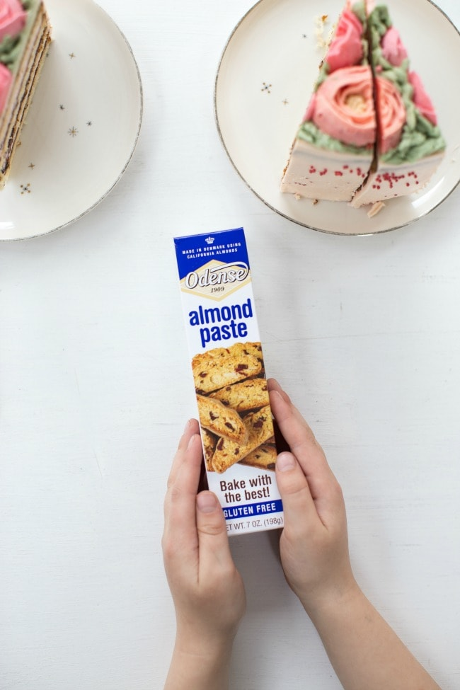 two hands hold a box of almond paste