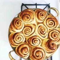 cinnamon rolls in a brass pan pan