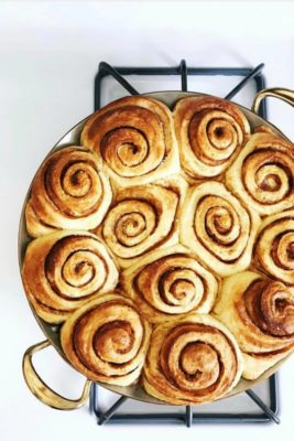 cinnamon rolls in a brass pan pan