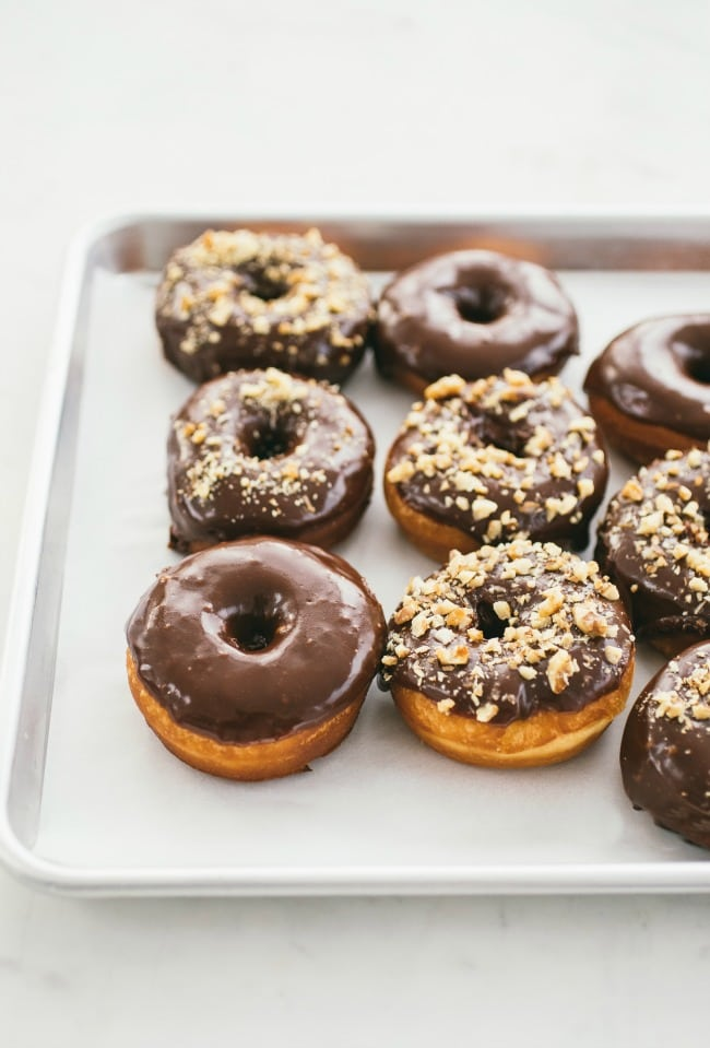 Raised Donuts with Chocolate Glaze and Candied Walnuts