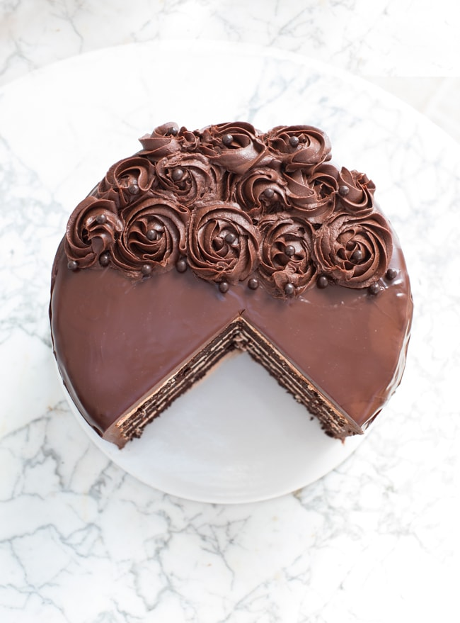 devil's food cake with a slice cut out of it, top down view.