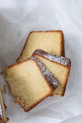 vanilla bundt cake sliced, on parchment